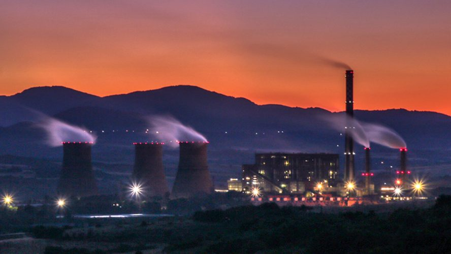 a dusky scene of a manufacturing site