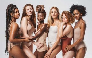 Diverse crew of women in nude-coloured body suits