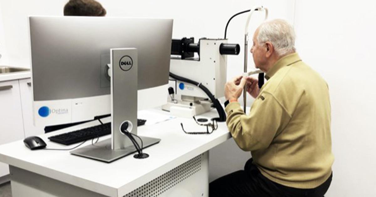Senior getting his eyes checked