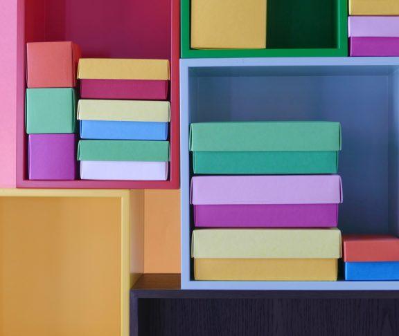 Multi colored boxes in the shelf