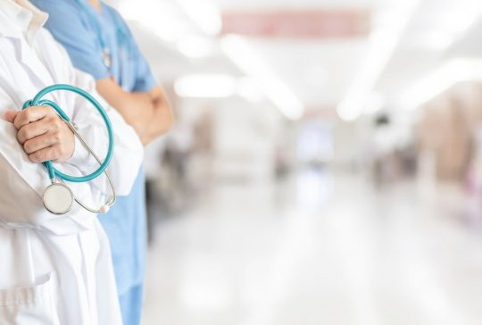 Surgeon and anesthetist doctor ER surgical team with medical clinic room background for emergency nursing care professional teamwork and patient trust in ICU hospital's hospitality concept