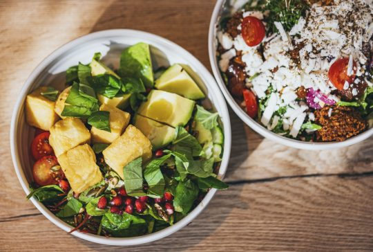 Delicious vegan, gluten free bowls with vegan cheese, chickpea-tofu or falafel and a lot of greens