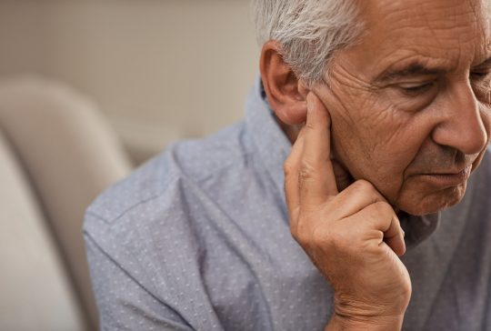 Senior man with hearing problems