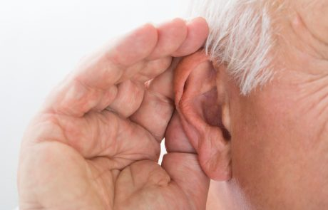 Close-up Of A Senior Man Trying To Hear Hand Over Ear
