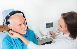 Senior man in hospital having ear test.