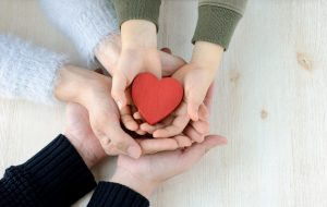 Heart in famiy hands