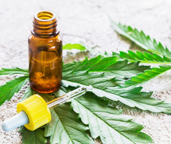 Cannabis - Marijuana oil extracts in jars and leaves for treatment.