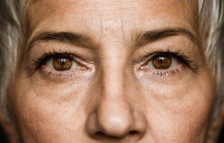 Close up of senior woman's brown eyes looking at camera.