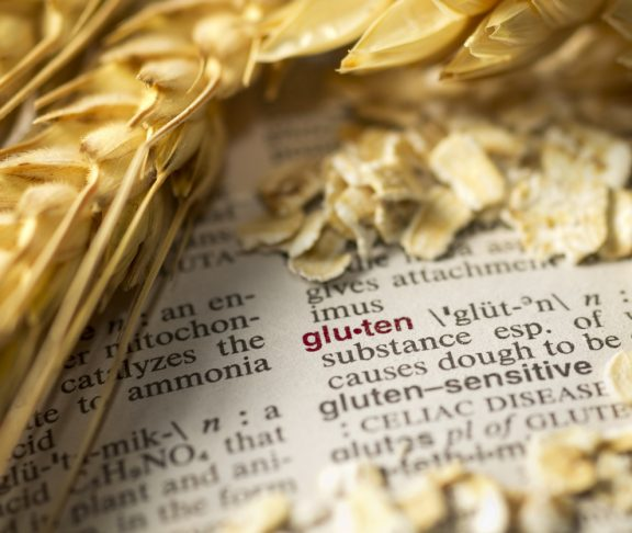 The definition of gluten as seen in a medical dictionary is surrounded by wheat and oatmeal.