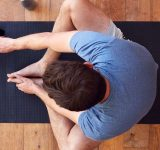 Men sitting on yogamat