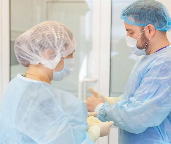 Doctors prepping for surgery